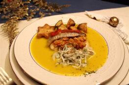 Merluza rellena de sepia, gula y gambas con velouté de verduras y berenjenas en tempura